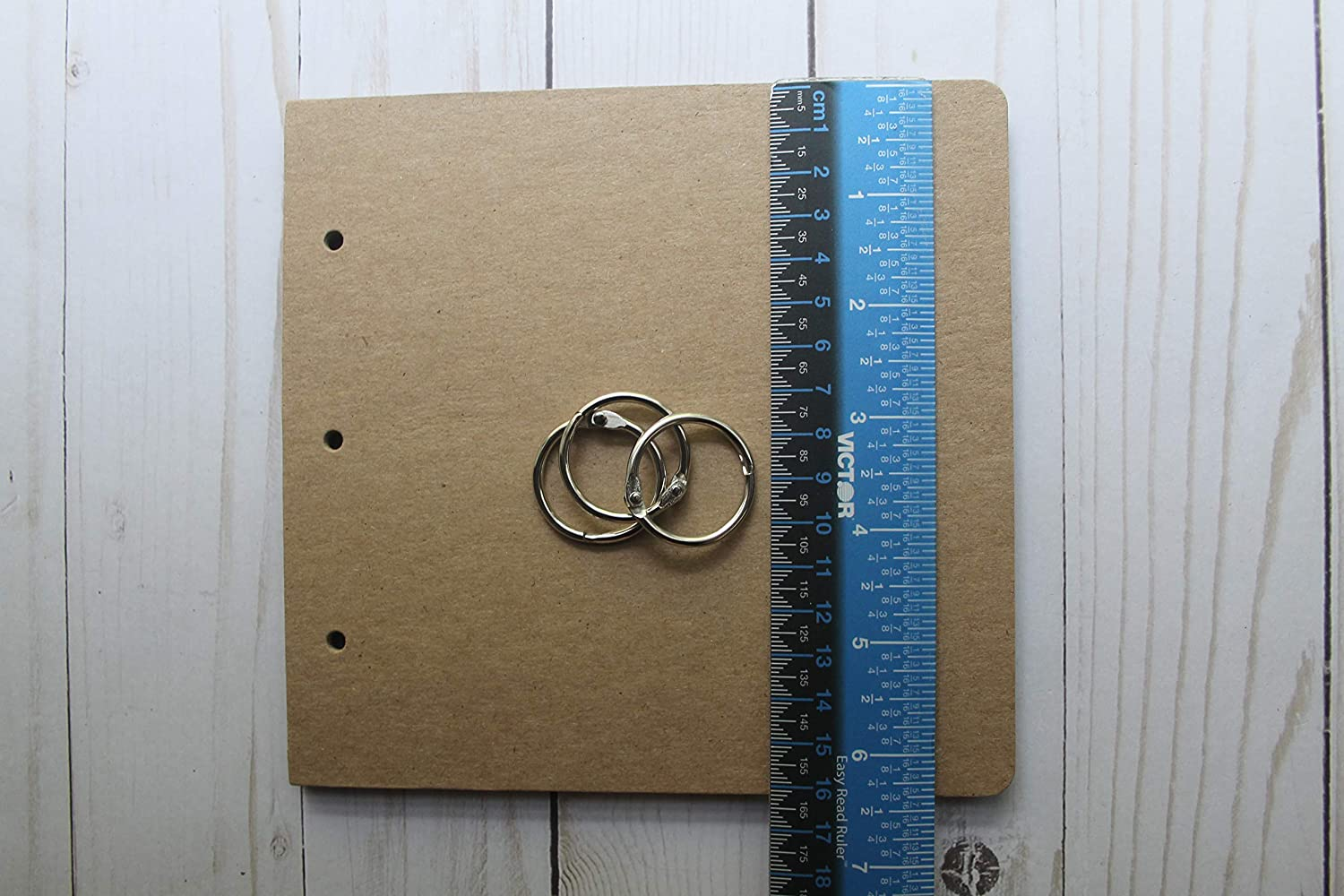 8 Page Chipboard die cut album with 3 holes and silver binding rings 6 7//8 wide x 6