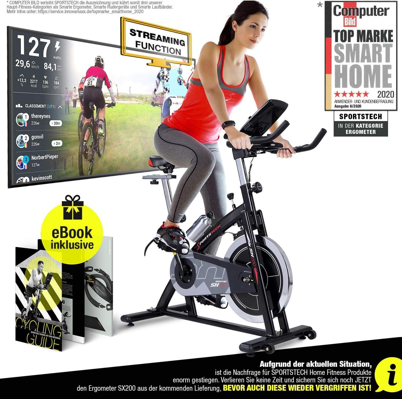Sportstech Profi Indoor Cycle SX200 - Bicicleta estáticacon control mediante aplicación de smartphone y Google Street View, volante de inercia de 22kg, reposabrazos, correa de pulsómetro compatible,