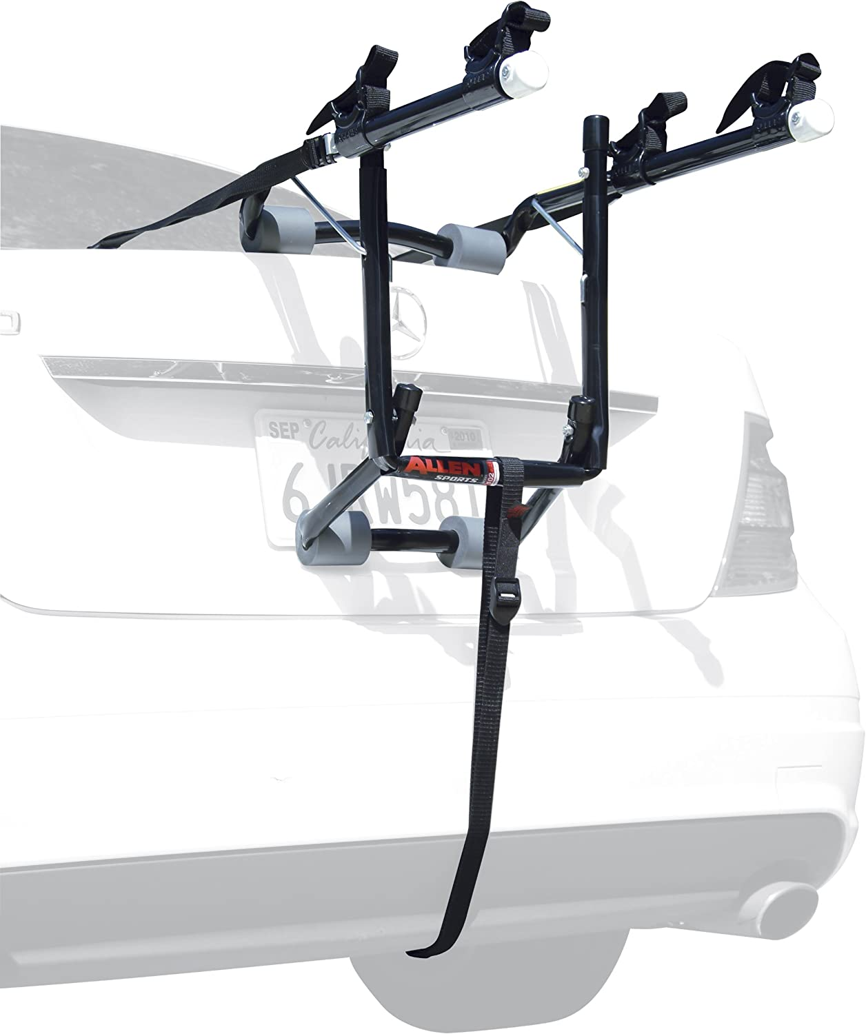Image of a bike rack attached to a car's trunk supported with straps.