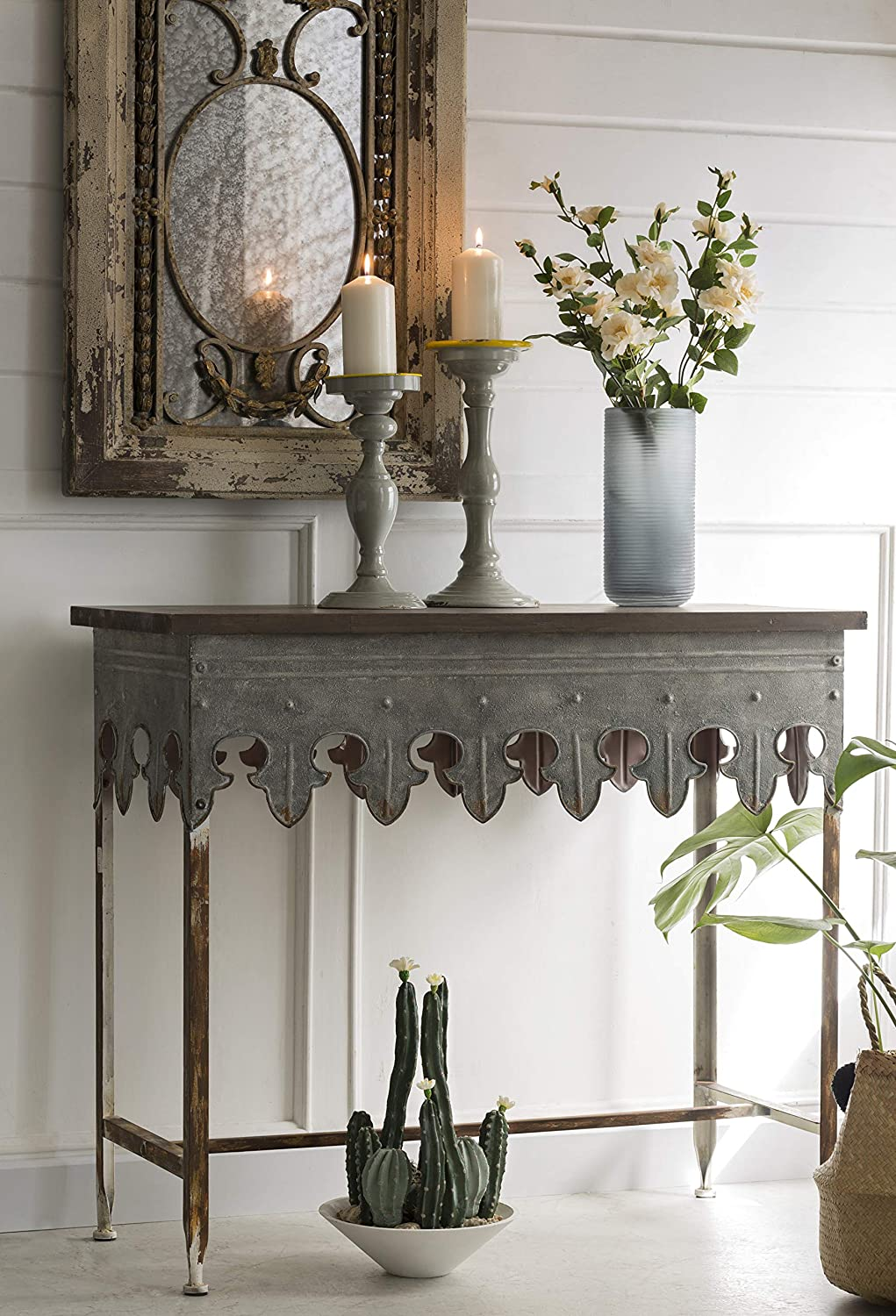 Rustic distressed zinc farmhouse style table with wood top.