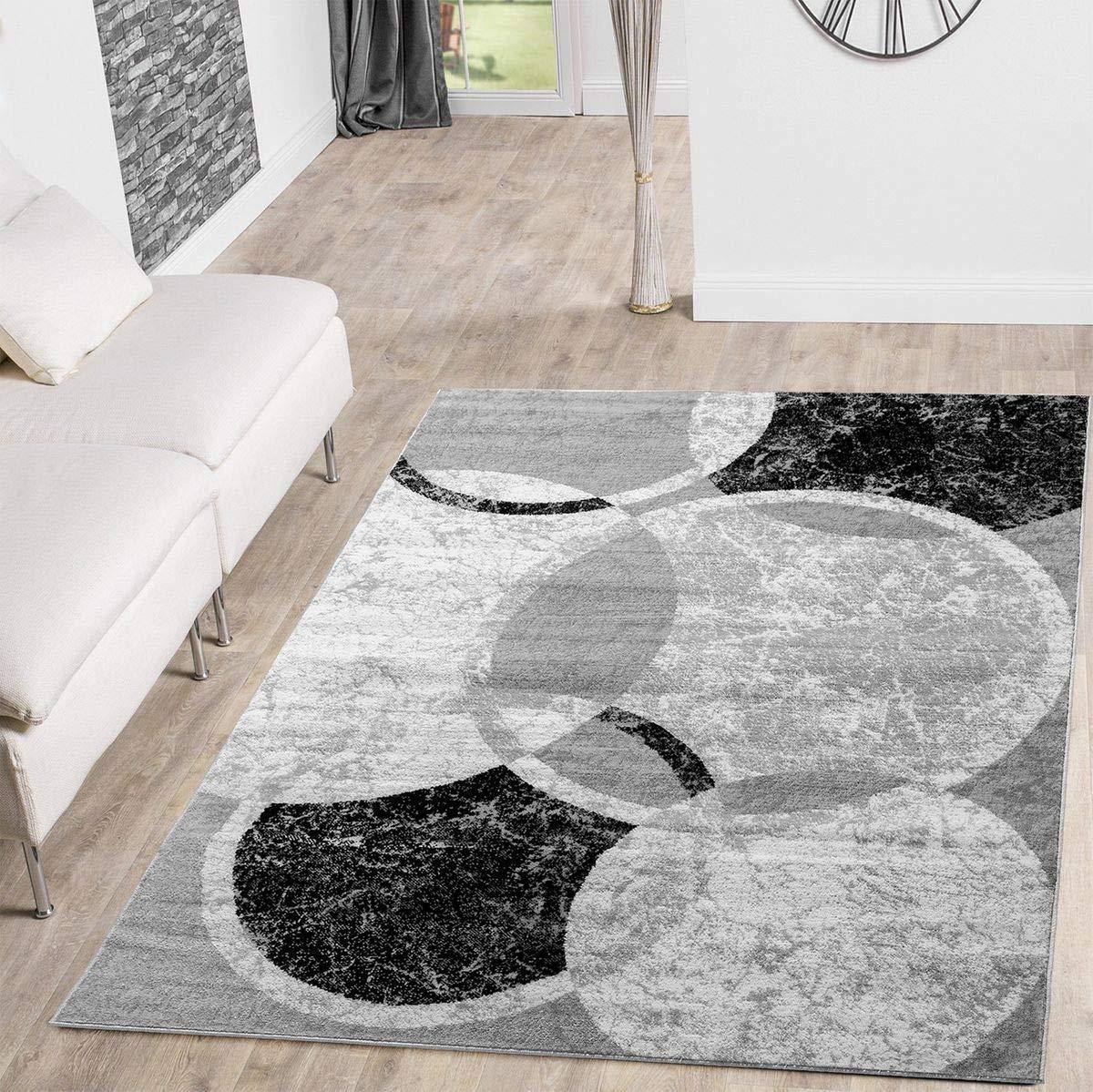 Alfombra moderna de diseño jaspeada con circulos en gris y negro
