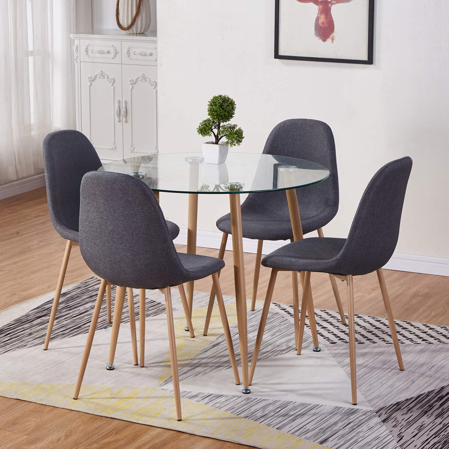 Goldfan Round Glass Dining Table And 4 Chairs Kitchen Dining Table And Grey Fabric Chairs With Metal Legs Dining Room Set Buy Online In Thailand At Thailand Desertcart Com Productid 164599221