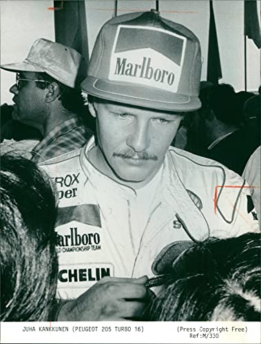 Vintage photo of Juha Kankkunen Race car driver.
