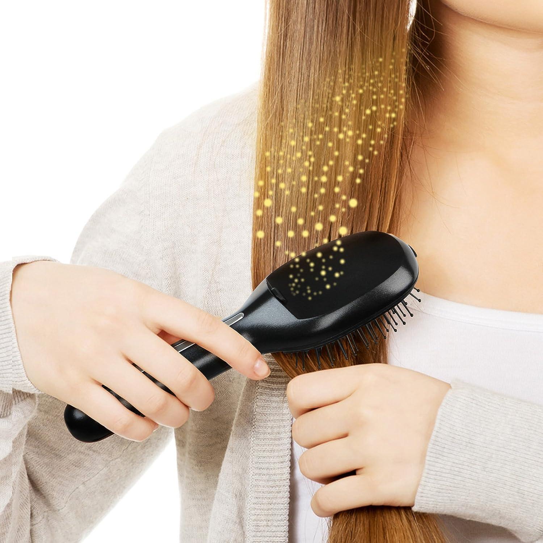 Jago - Cepillo de pelo con tecnología iónica (función de masaje vibratorio) de color negro: Amazon.es: Salud y cuidado personal