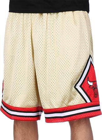 84dfddd525 Mitchell & Ness Swingman Chicago Bulls Pantalón corto gold: Amazon ...