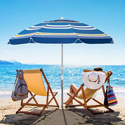 rainbow colored beach umbrella shading two people in beach chairs