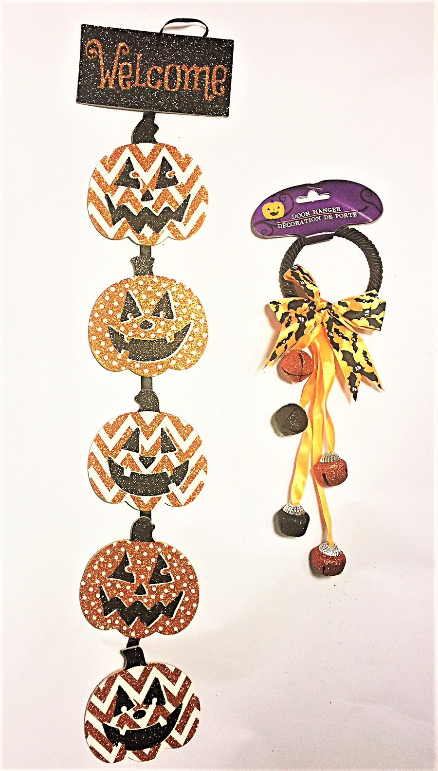 Decorative Stacked hanging jack-o-lanterns linked by ribbon, with coordinating door knob bells.