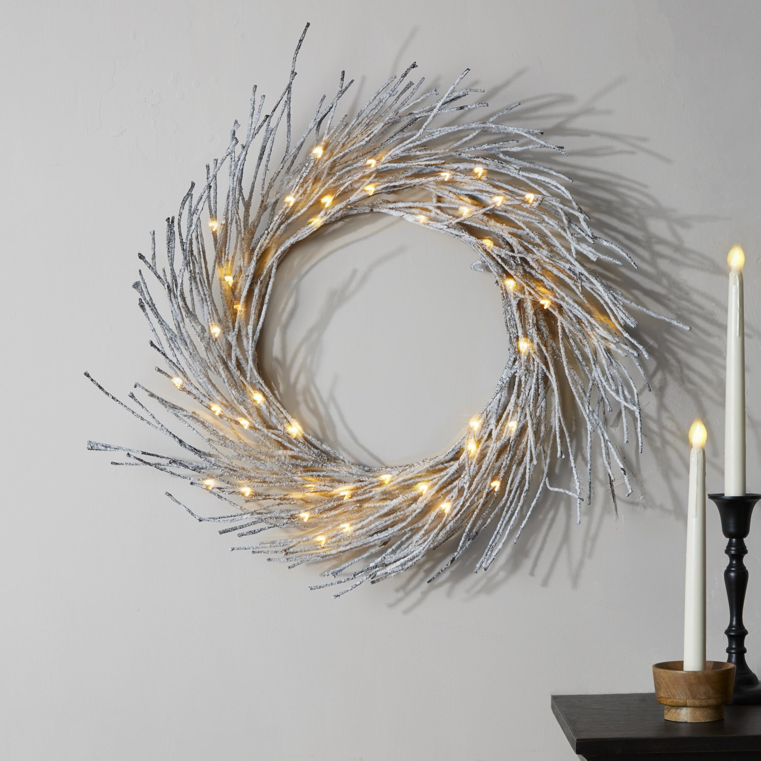 LampLust Pre-lit Flocked Snow Wreath, 42 Warm White LED Lights | 23 Inches, Bendable Wires, Indoor Use, Timer Option, Battery Operated by LampLust