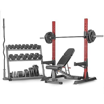 XMark CHAMPION Juego con estante de almacenamiento, estante multiprensa para sentadillas, banco de musculación, barra olímpica VOODOO, barra olímpica, ...