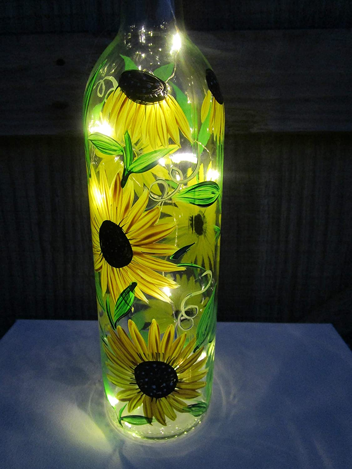 Hand painted bottle light with pink and yellow flower design