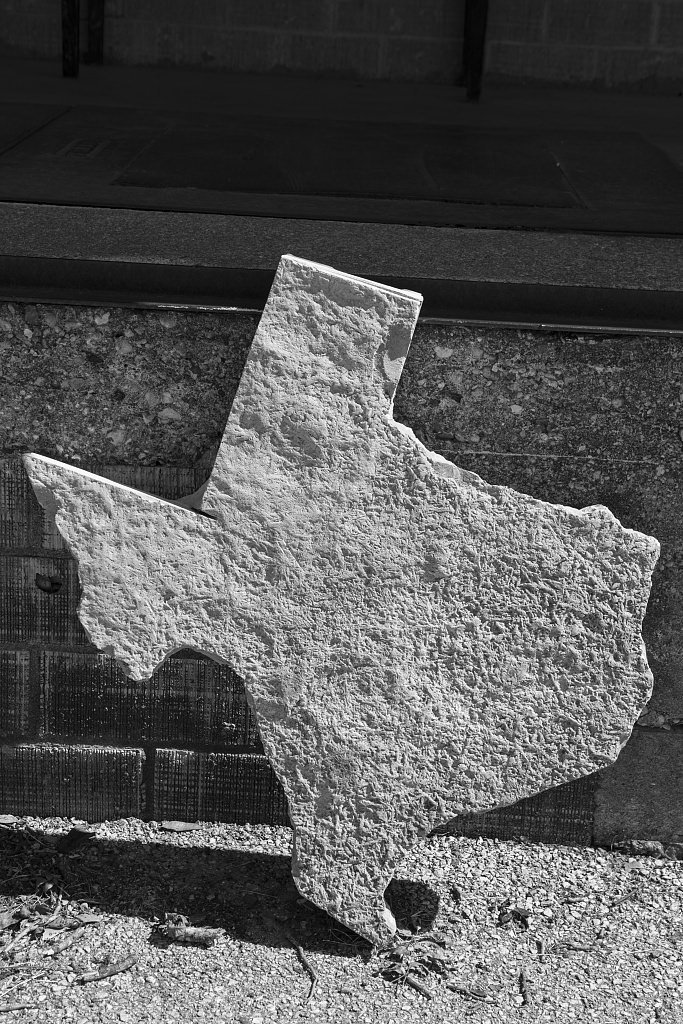 Vintography 18 x 24 B&W Photo Texas Outline in Stone, propped Against a Wall at The Old Hye Store Post Office in Blanco County, west Johnson City, Texas 2014 Highsmith 24a