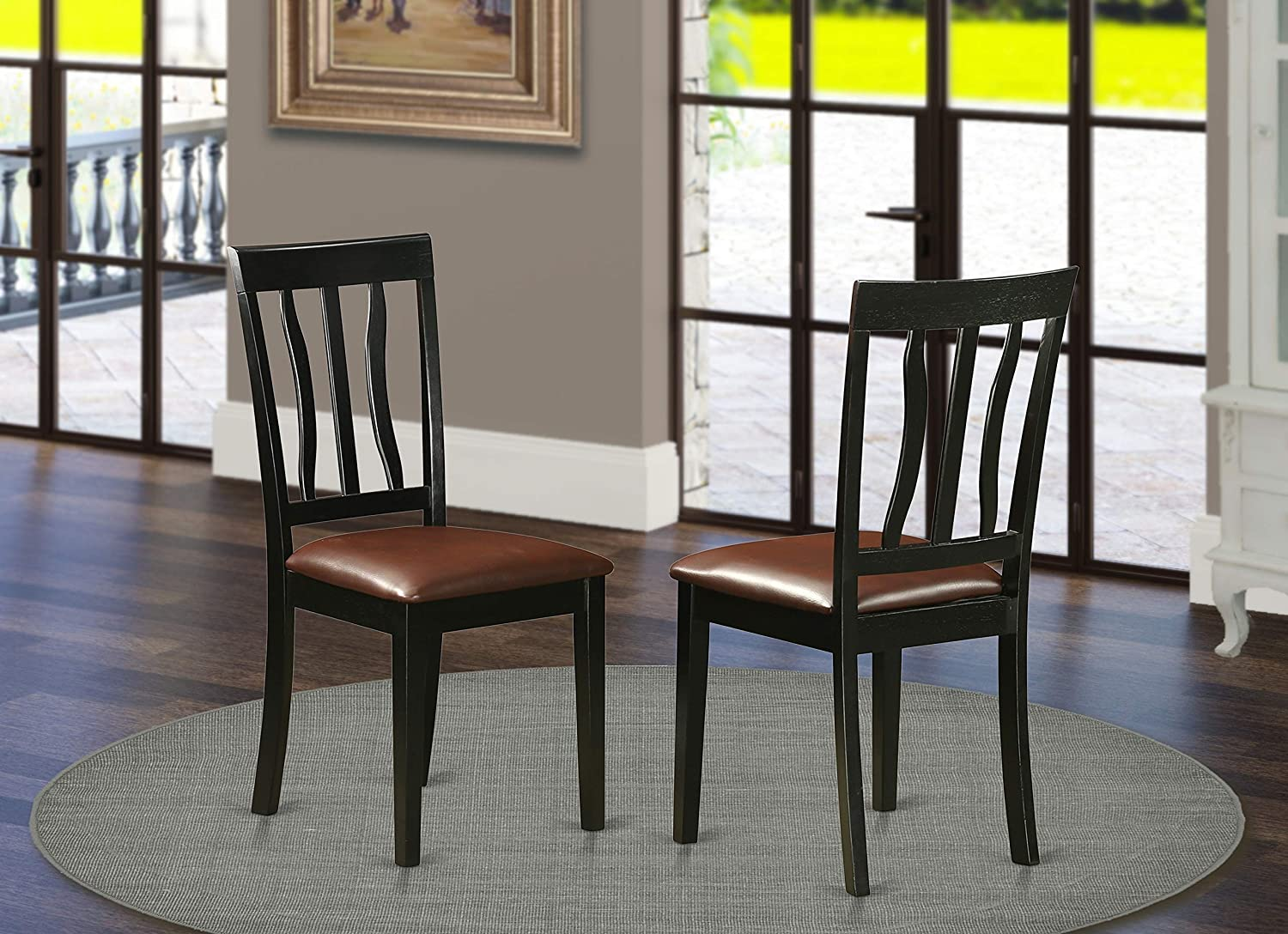 Amazon Com East West Furniture Antique Dining Room Chair Faux Leather Seat And Black Finish Solid Wood Frame Padded Dining Chair Set Of 2 Chairs