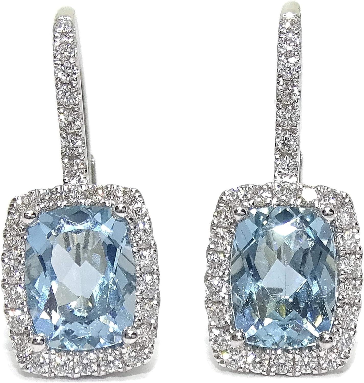 Pendientes de diamantes y topacios azules en oro blanco de 18k. 3.58ct de topacios y 0.48cts de diamantes. Cierre monaquela. 2.20cm de largos