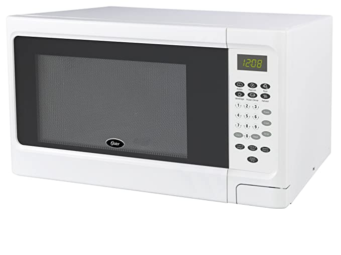 Amazon.com: Oster OGCMS311WE-10 1.1 cu. Ft. horno microondas ...