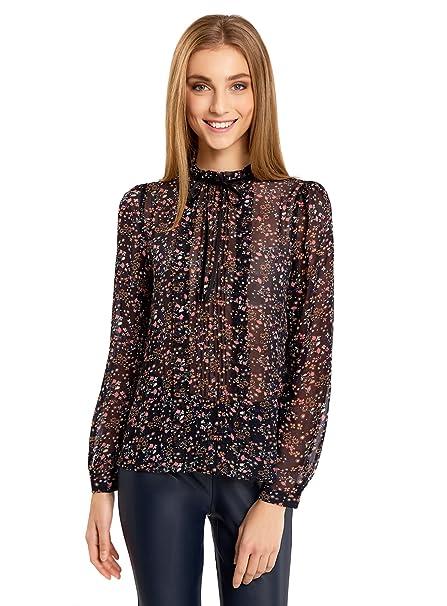 Bonita blusa de gasa con bolantes en el cuello y lazo. Opción de colores.