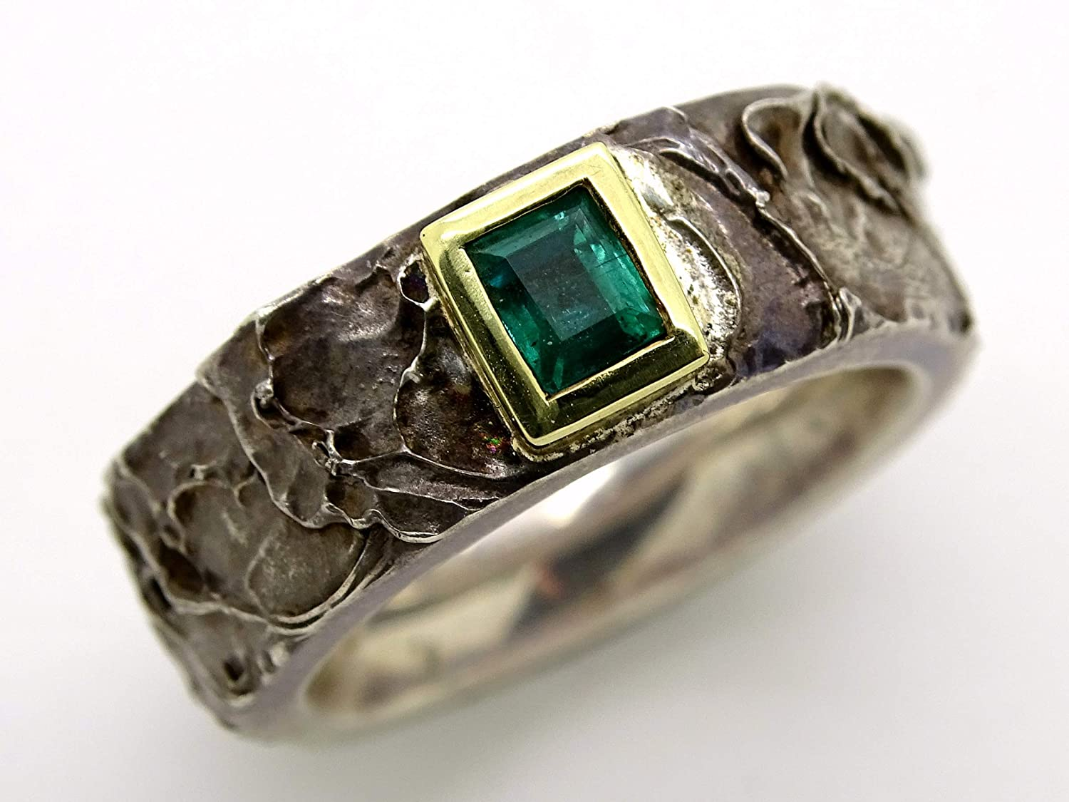 It is a graphic of Amazon.com: mens emerald ring gold silver, celtic wedding ring for