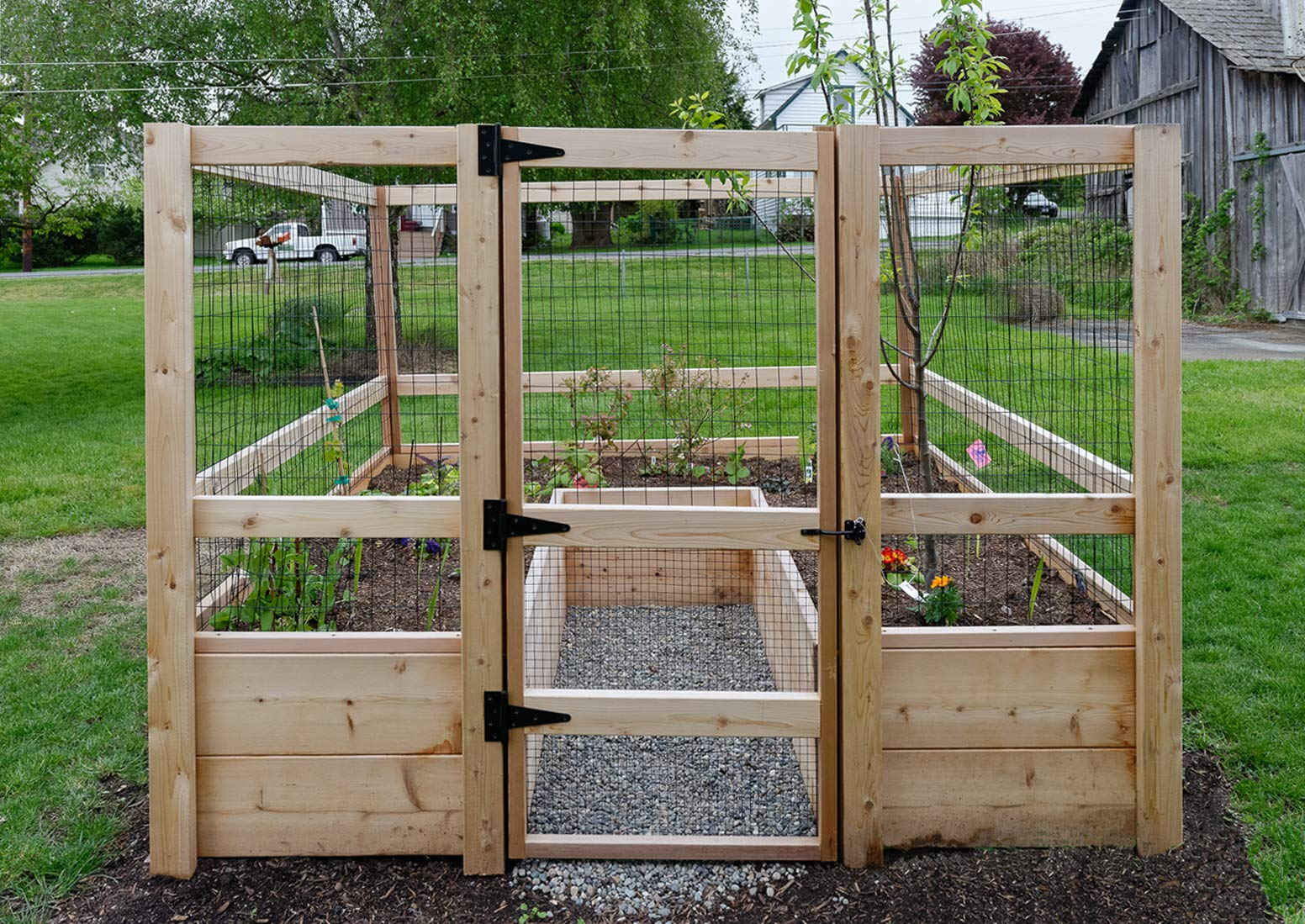 """Deer-Proof Just Add Lumber Vegetable Garden Kit - 8'x8' 6 DOES NOT INCLUDE LUMBER. Kit includes everything but the lumber: 8 Raised bed brackets, black nylon netting for fencing/trellis, black vinyl-coated steel wire for gate, ceramic-coated rust resistant screws, plus all other required hardware and detailed instructions Buy your own rough lumber locally - Build the ultimate vegetable garden with this kit. Required rough construction lumber : (10) 2""""x10""""x8'; (1) 2""""x10""""x6'; (6) 2""""x4""""x12'; (2) 2""""x4""""x8'; (3) 2""""x2""""x12'; (1) 2""""x2""""x8'; (4)1-5/8""""x1-5/8""""x12' (actual size). Note: the lumber boards will need to be further cut into the sizes described in the assembly instructions Gated garden keeps out deer, rabbits and dogs"""