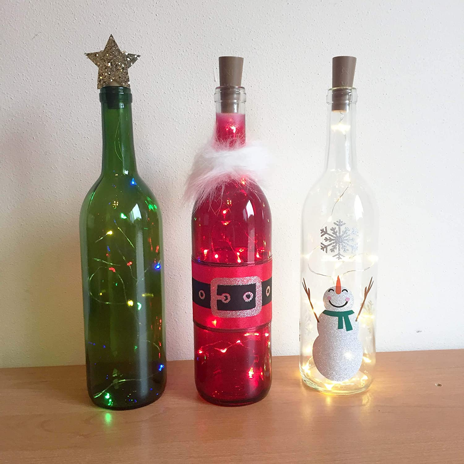 Wine Bottle Christmas Tree Craft.Holiday Wine Bottle Decorations With Lights Santa Snowman Christmas Tree Wine Bottle Decor Wine Bottle Crafts Holiday Decorations