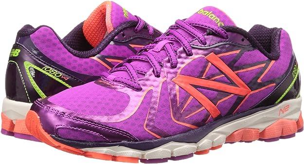 New Balance W1080 - Zapatillas de Running de Material sintético para Mujer Lila/Neonorange, Color Violeta, Talla 42.5 EU (8.5 Damen UK): Amazon.es: Zapatos y complementos