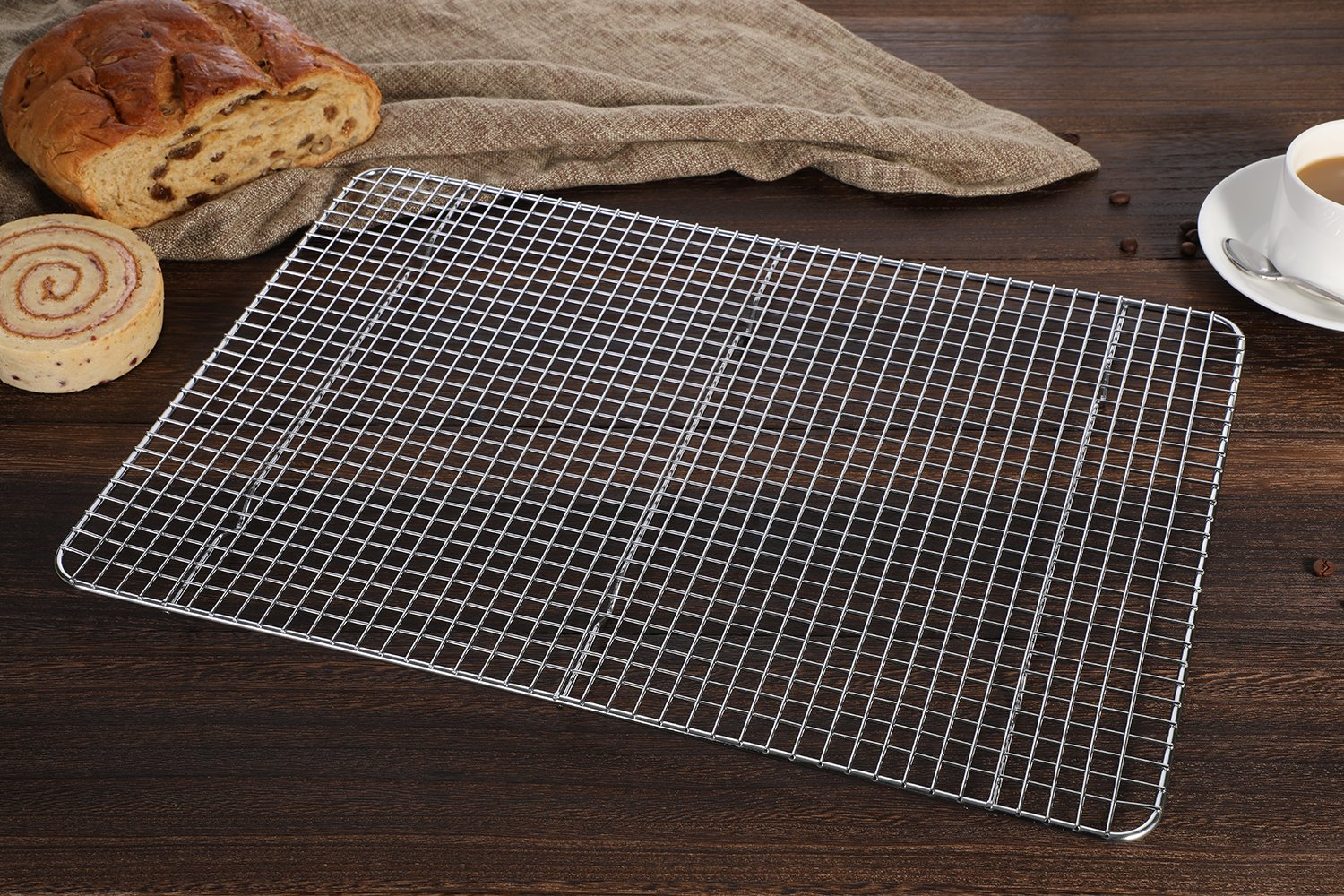 "Hiware Cooling Rack for Baking - 11.8"" x 16.5"" - Stainless Steel Wire Cookie Rack Fits Half Sheet Pan, Oven Safe for Cooking, Roasting, Grilling 7 SOLID STAINLESS STEEL GRID CONSTRUCTION - Hiware's cooling rack is made of high quality [GRADE] stainless steel that is made to last for years. The tight grid design gives stability to the rack, which makes it easy to balance baked goods, meats, fruits, and vegetables without the possibility of them falling through the slats. OVEN AND GRILL SAFE - This commercial-grade rack resists heat up to 575 degrees Fahrenheit making it perfect for use in the oven or grill. This versatile rack is the perfect complement to any kitchen and holds up to 20 pounds of food without sagging or bending. PERFECT SIZE - Measuring 11.8""x16.5"", the Hiware rack fits inside a half sheet (13""x18"") cookie pan or comfortably on a countertop. After use, it is easy to store in your cabinet or drawer."