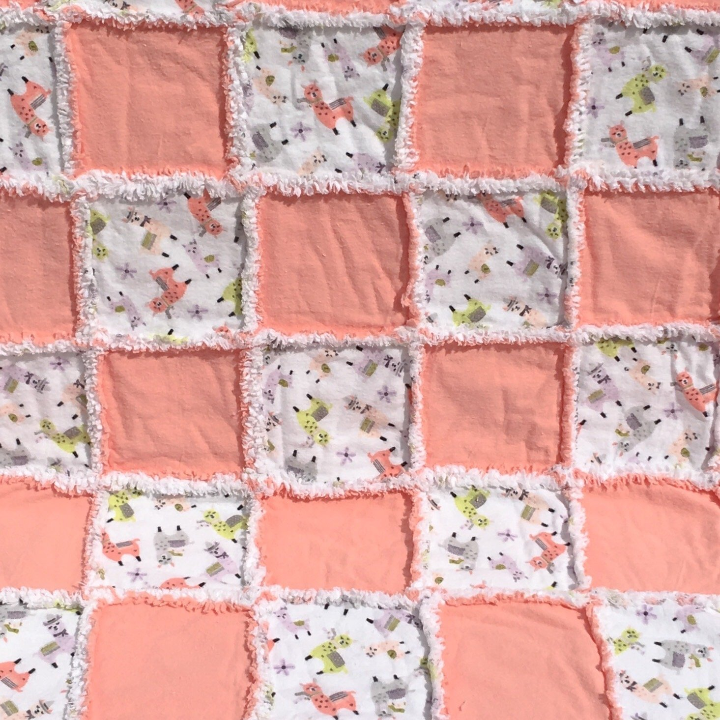 Flannel baby quilt peach with colorful smiling llamas