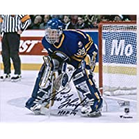 "$84 » Dominik Hasek Buffalo Sabres Autographed 8"" x 10"" Blue Jersey In Net Photograph with""HOF 2014"" Inscription - Fanatics Authentic Certified"