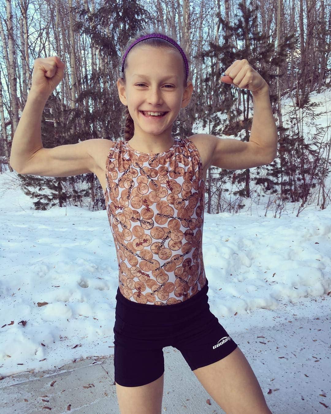 COOLOMG Shorts de Sport pour Enfants Filles avec Poche Lat/érale Yoga Fitness Leggings Pantalon Court Collants de Course Entra/înement Danse Gym Jogging Femmes