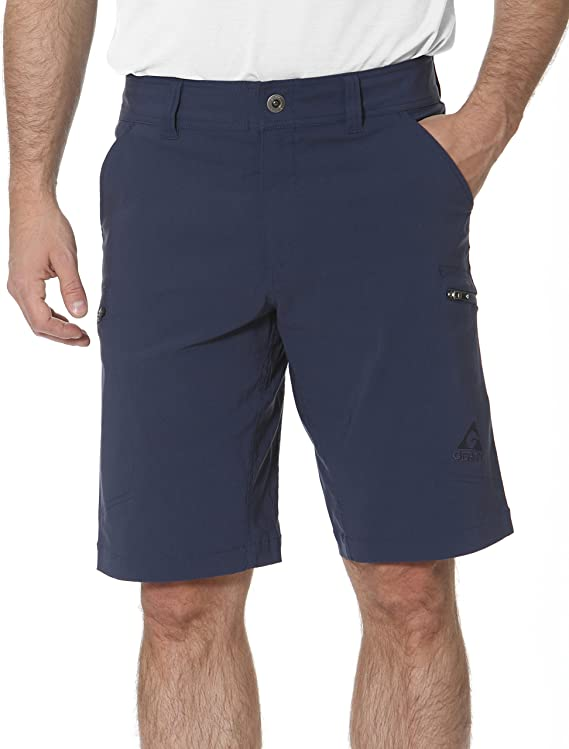Photo of an unidentified man wearing a navy blue cargo shorts with two side pockets, one hand inside it.