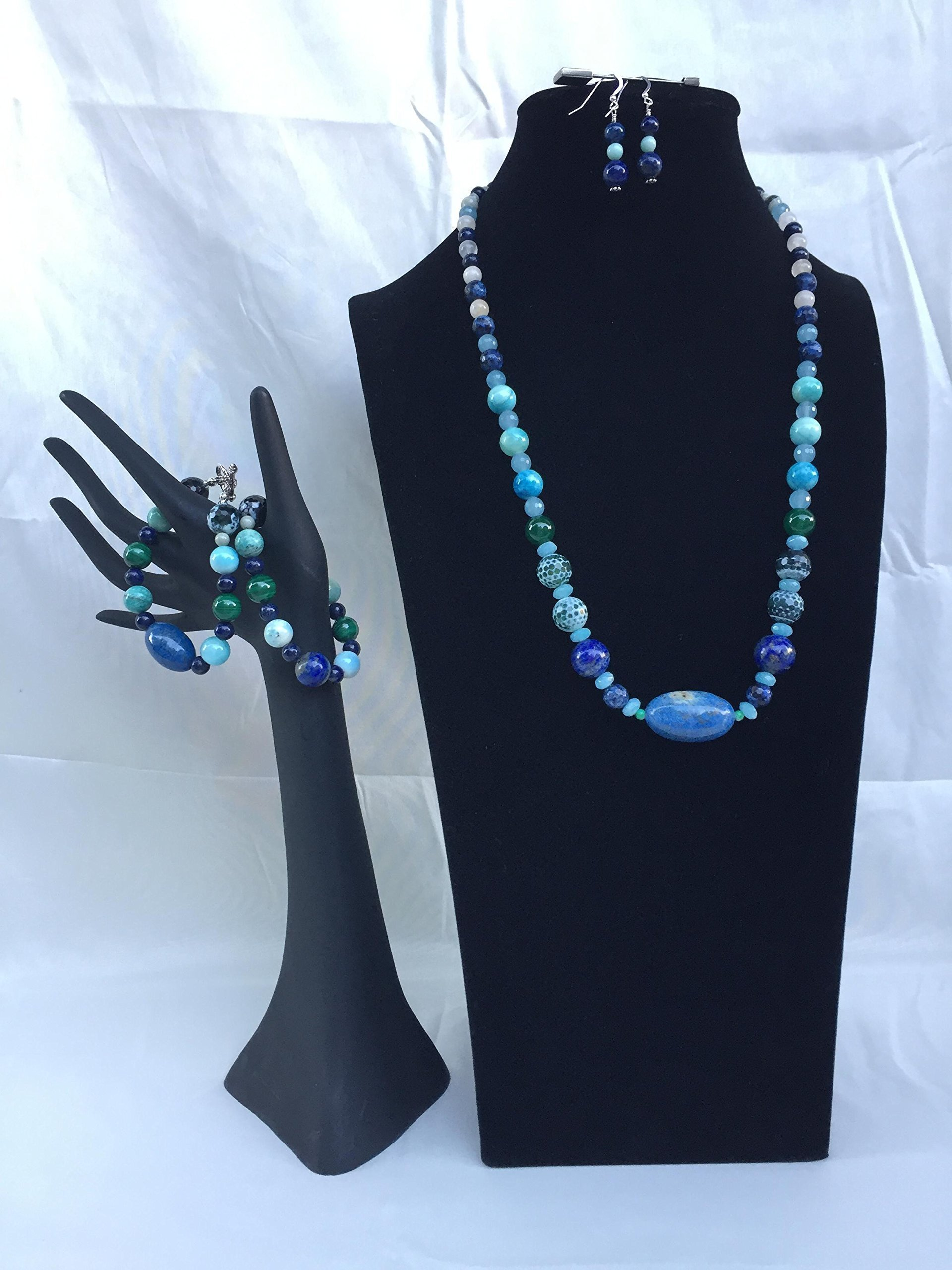 Wow factor handmade Lapis jewelry set with a necklace, two bracelets and matching dangle earrings. Large Lapis center bead with mixed gemstones. One of a kind