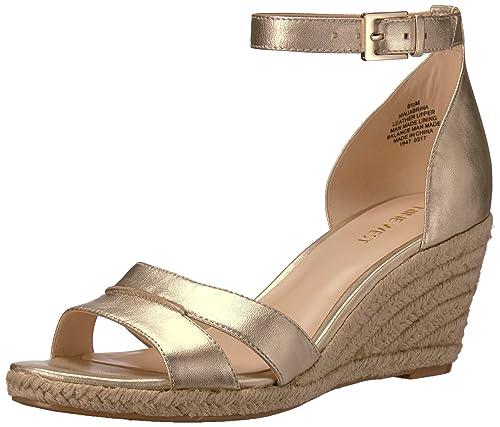 306870dbca7 Nine West Women s Jabrina Metallic Wedge Sandal Light Gold 7.5 ...