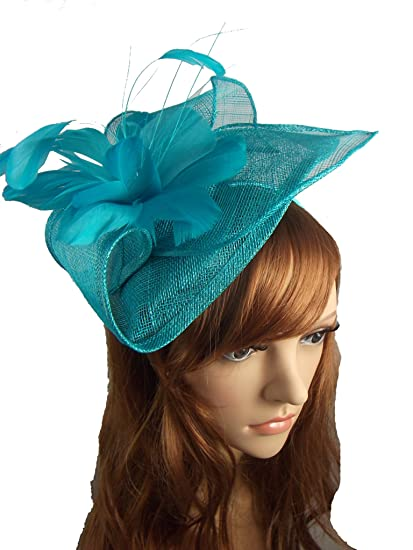 0698cde2a5d51 Turquoise Blue Leaf Sinamay Fascinator with Feather Flower - Hat Wedding  Races  Amazon.co.uk  Clothing