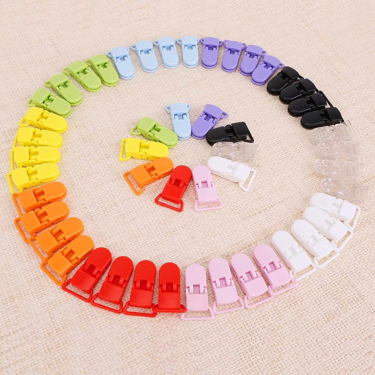 50pcs Pinza para chupetero de KAM plástico 10 colores