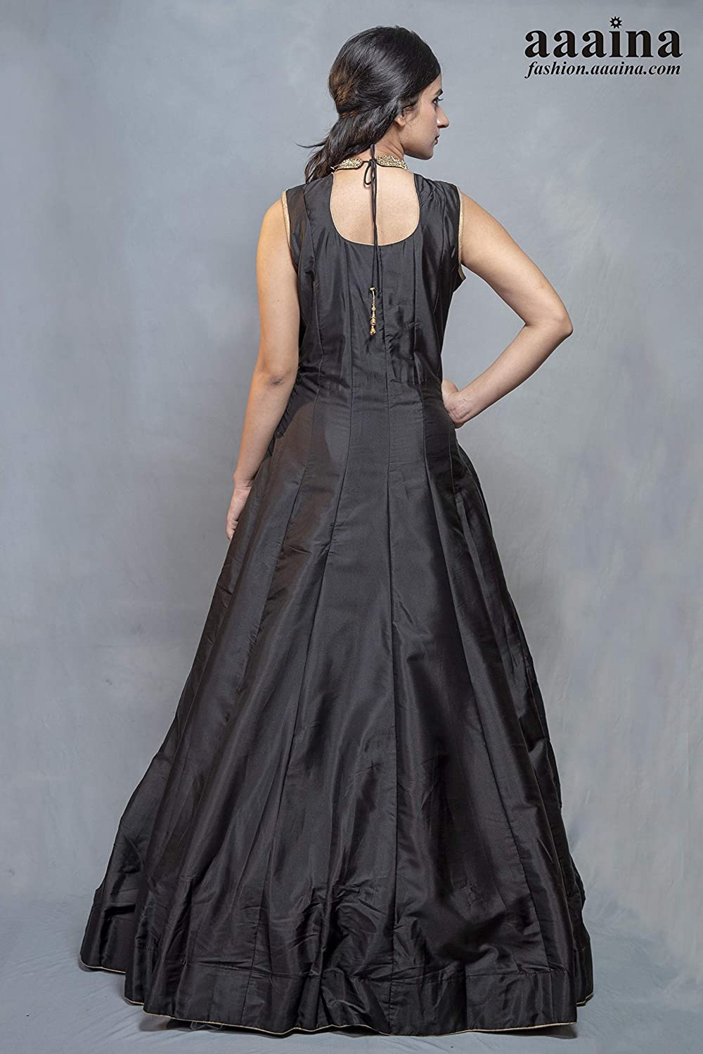 d80a1ea3cf aaaina® Silk Fabric Fully Flaired Black Floor Touch Gown Style with Heavy  Golden Stone Rays on Neck