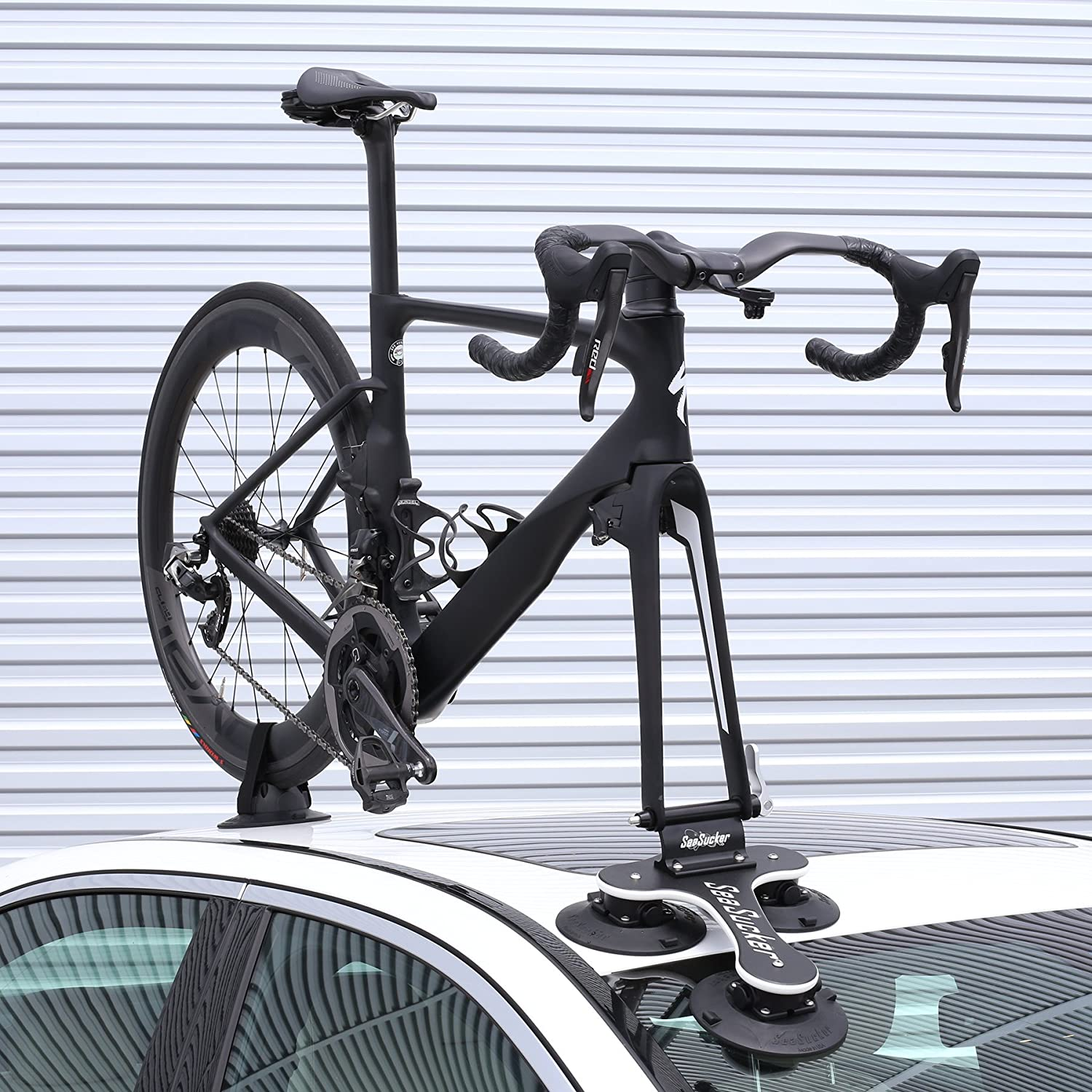 A bike on top of a car attached to a bike rack