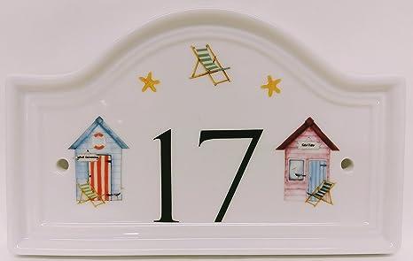 De casetas de playa y sillas la Puerta número de porcelana con texto en inglés cualquier