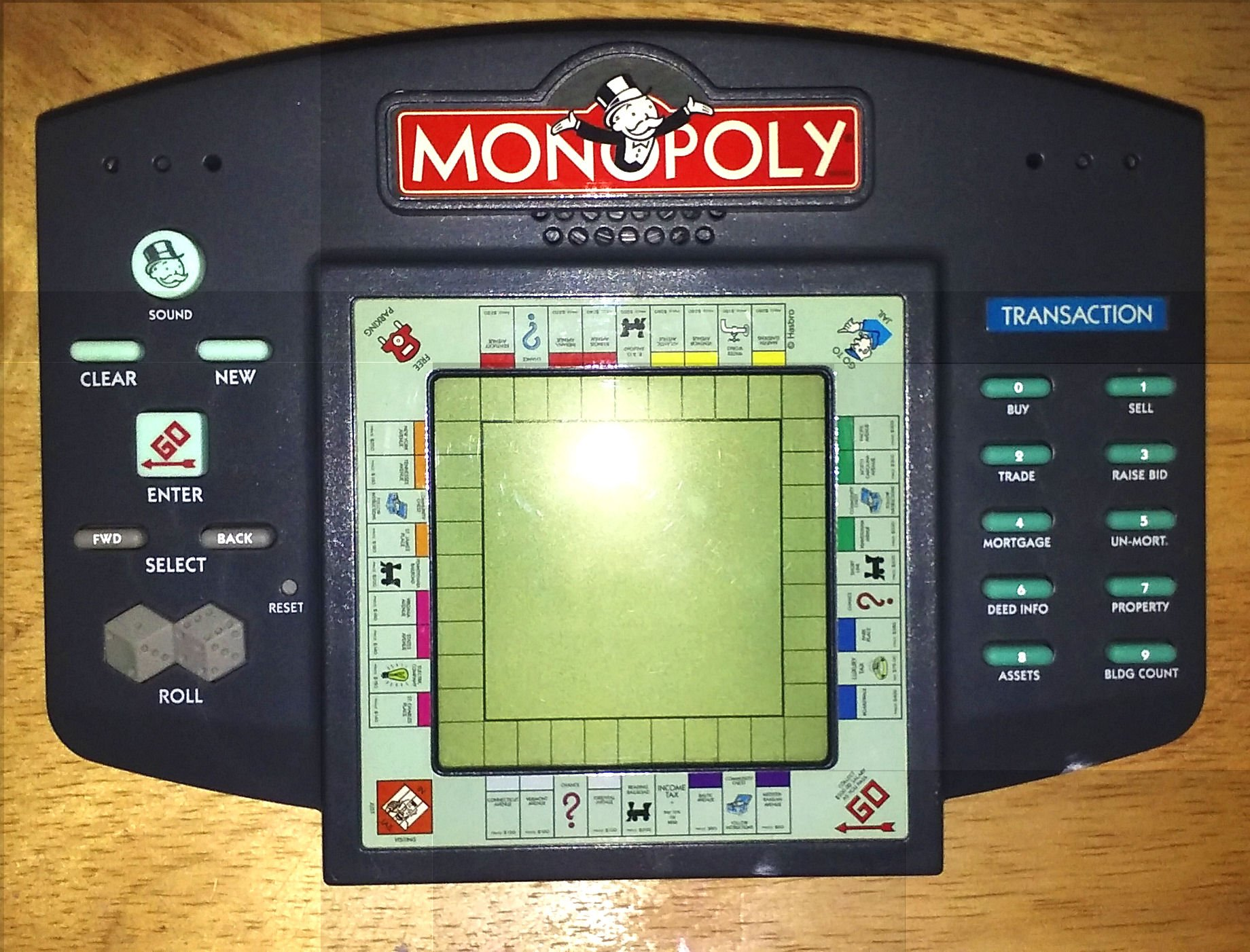 Talking Monopoly Electronic Hand Held LCD Game: Amazon.es: Hasbro: Libros