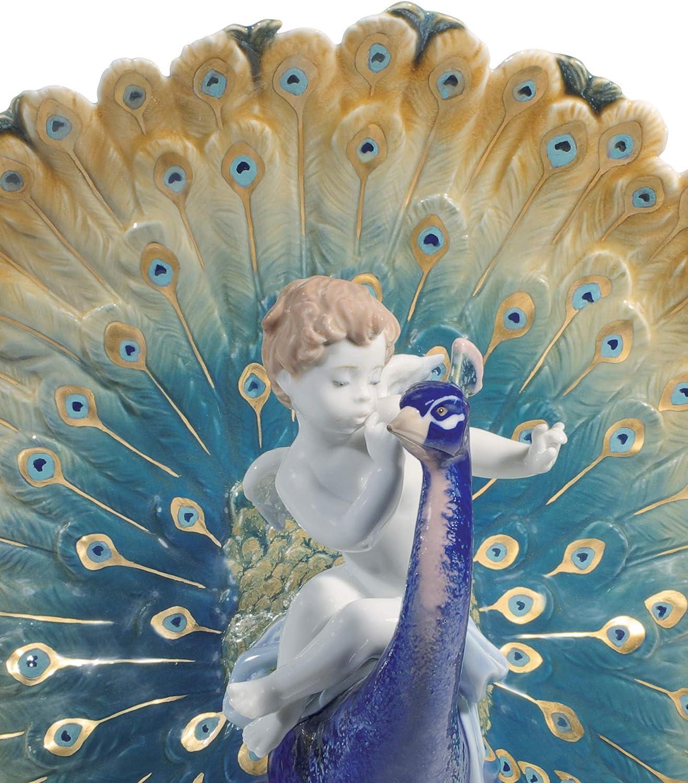 Amazon Com Lladró Cherub On A Peacock Figurine Limited Edition Porcelain Peacock Figure Home Kitchen
