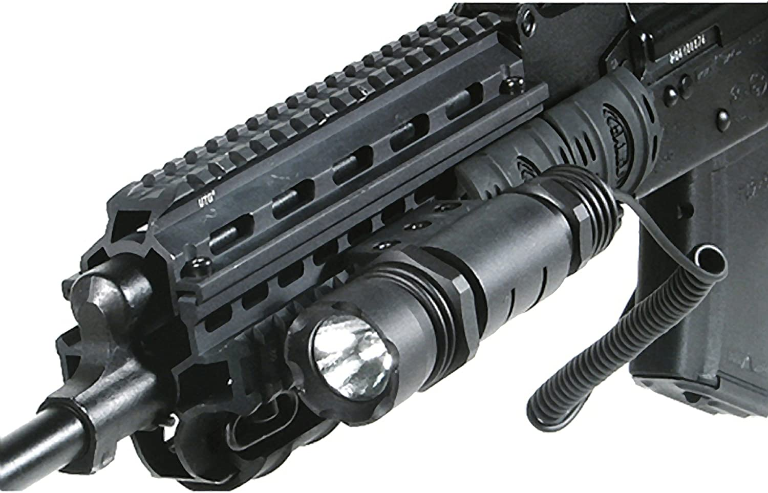 An image of a pistol light in black color attached on the left side of a black rifle.