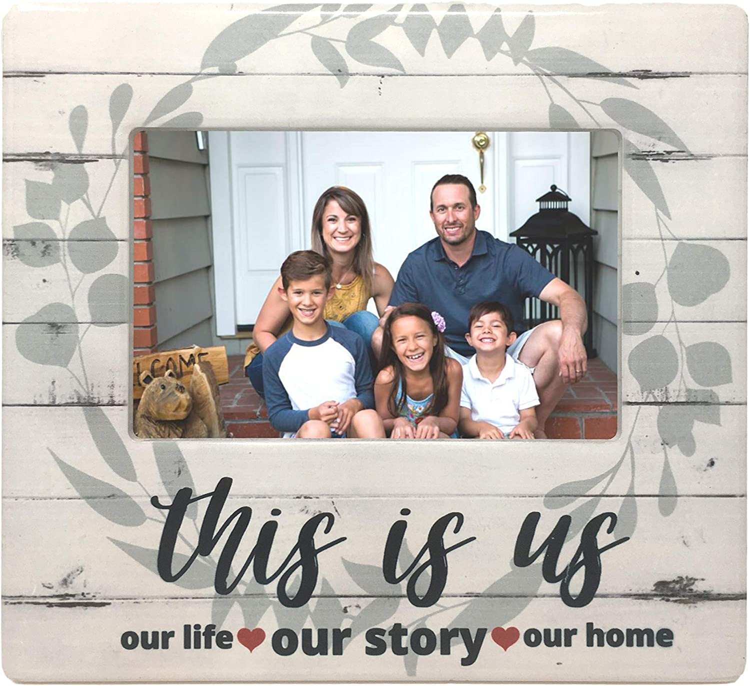 BANBERRY DESIGNS This is Us Picture Frame - Family Photo Plaque with Farmhouse Style Theme - Whitewashed Barnboard Background with Sage Green Wreath - Our Life Our Story Our Home - 4 X 6 Picture Open