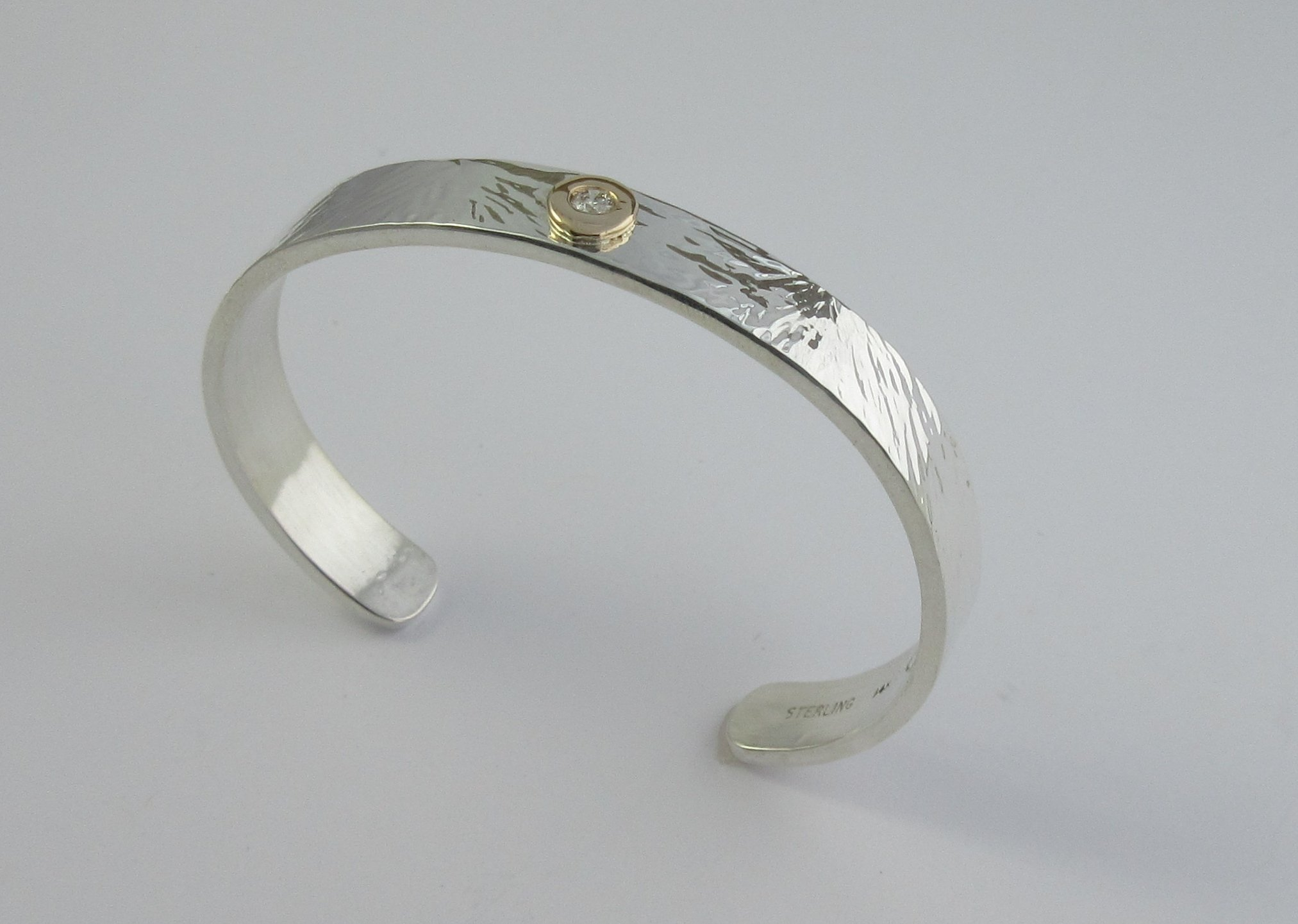 Sterling silver cuff bracelet with 14kt yellow gold diamond