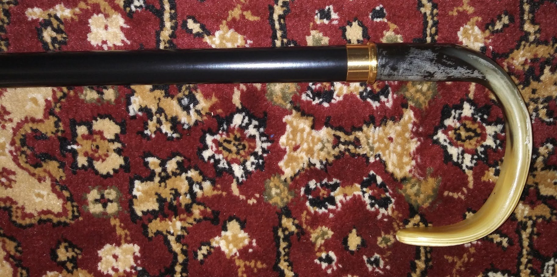 Walking Cane-Flat nose. This walking stick cane has an imported genuine horn handle. This walking aid has a black ebony tapered shaft. This horn handle cane has a weight capacity of 250 pounds and 36 inch shaft