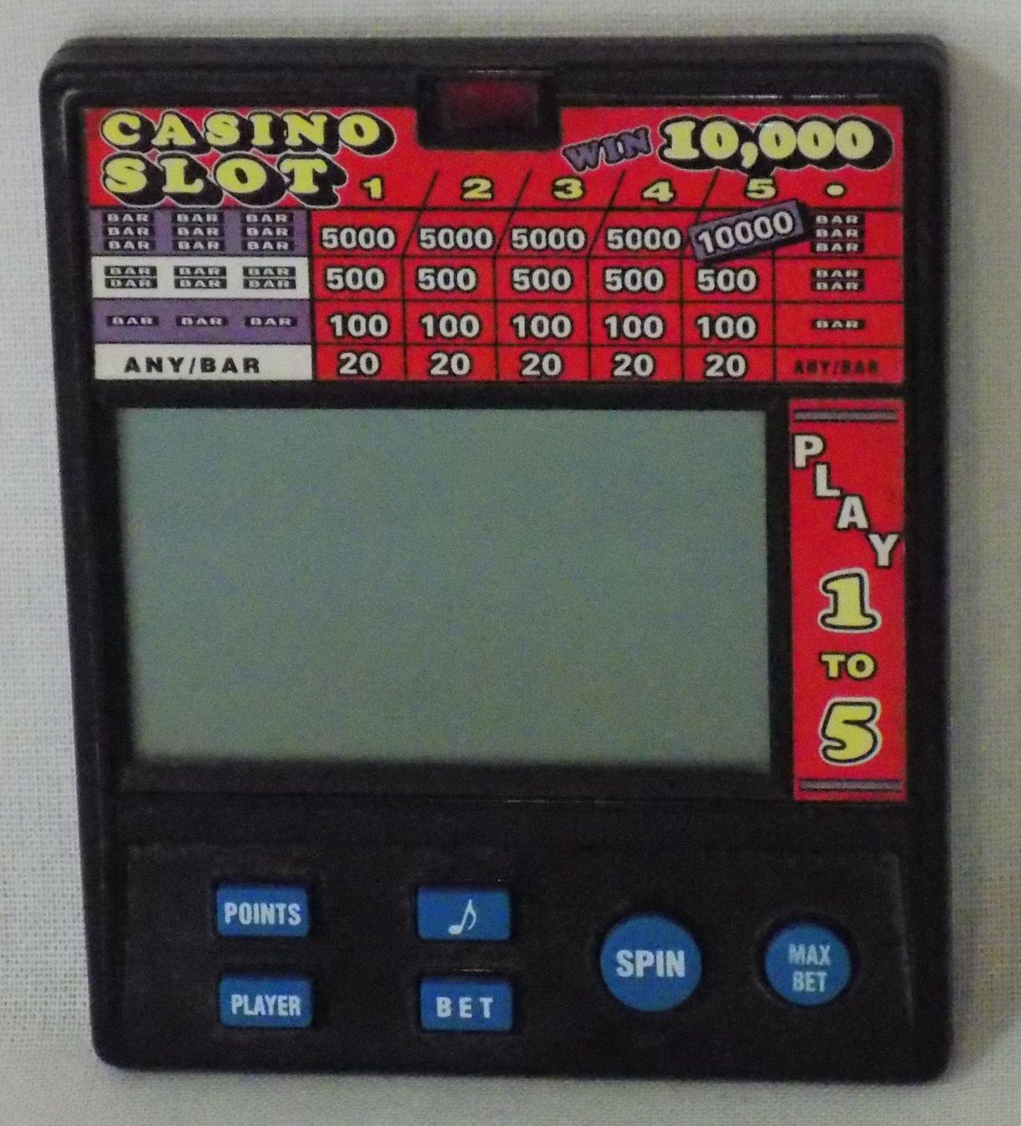 Radica Casino Slot 10,000 Electronic Hand Held Game #1470