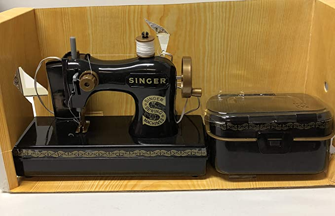 Maquina de coser singer antigua precio