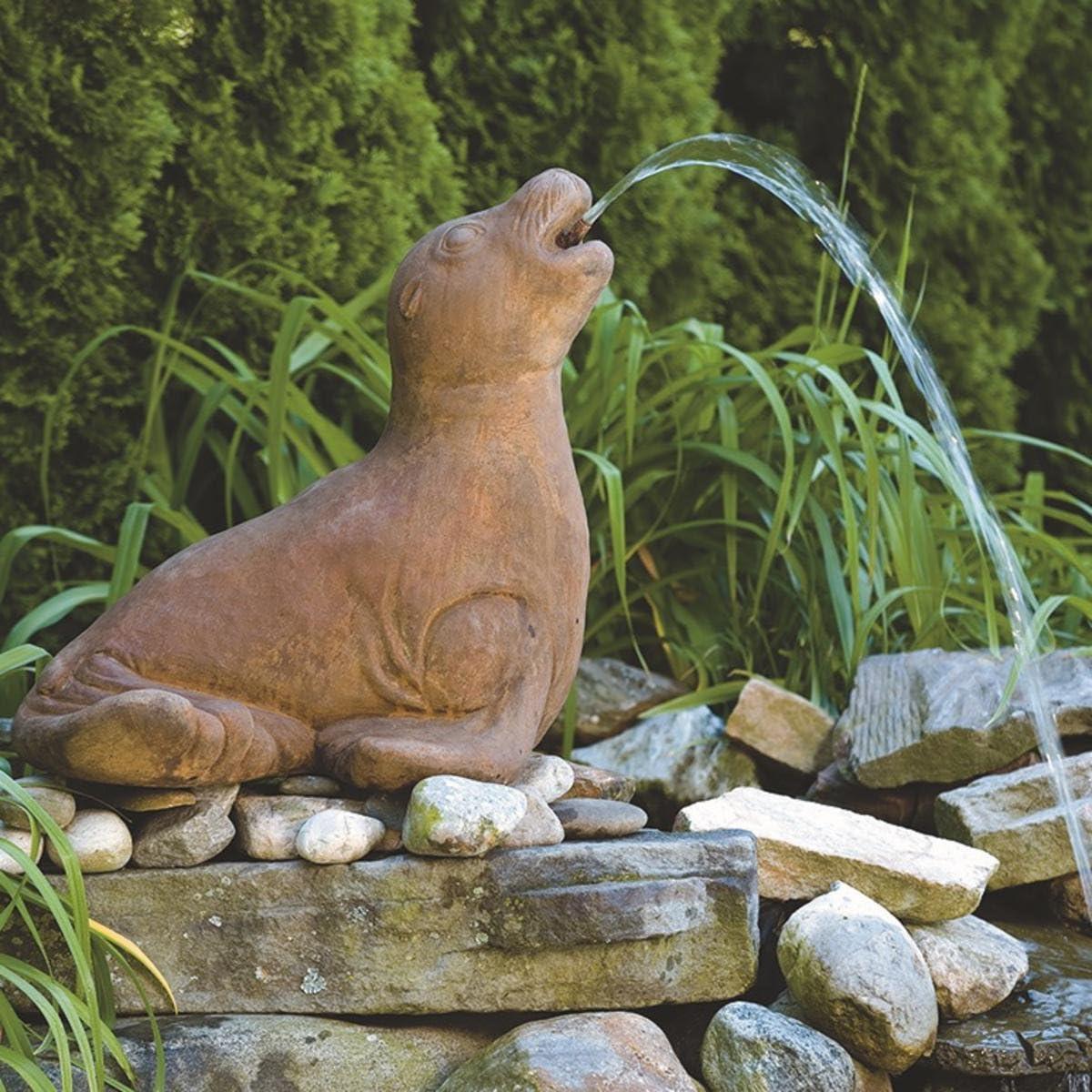 Descanso cierre fundido piedra estanque de jardín Spitter: Amazon.es: Jardín