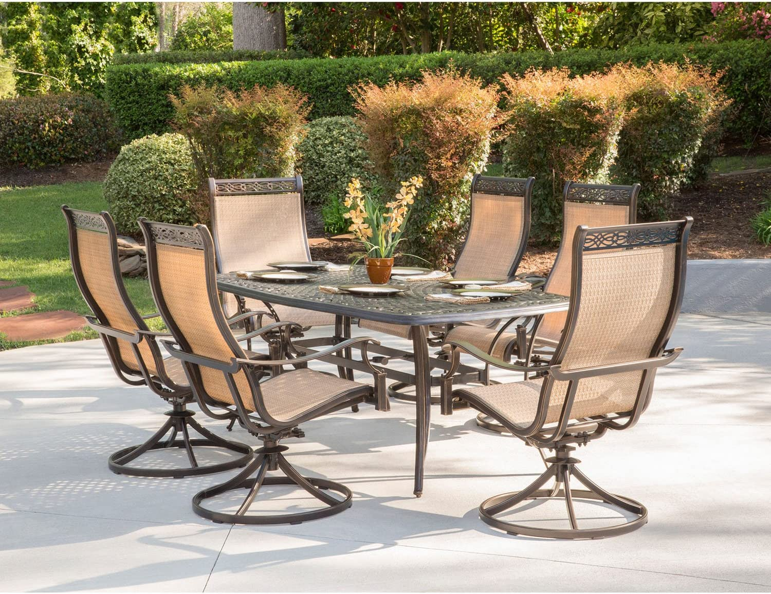 Amazon Com Hanover Mandn7pcsw 6 Chairs And Rectangle Cast Aluminum Table Brushed Bronz Manor 7 Piece Outdoor Patio Dining Set 6 Sling Swivel Rocker Tan Garden Outdoor