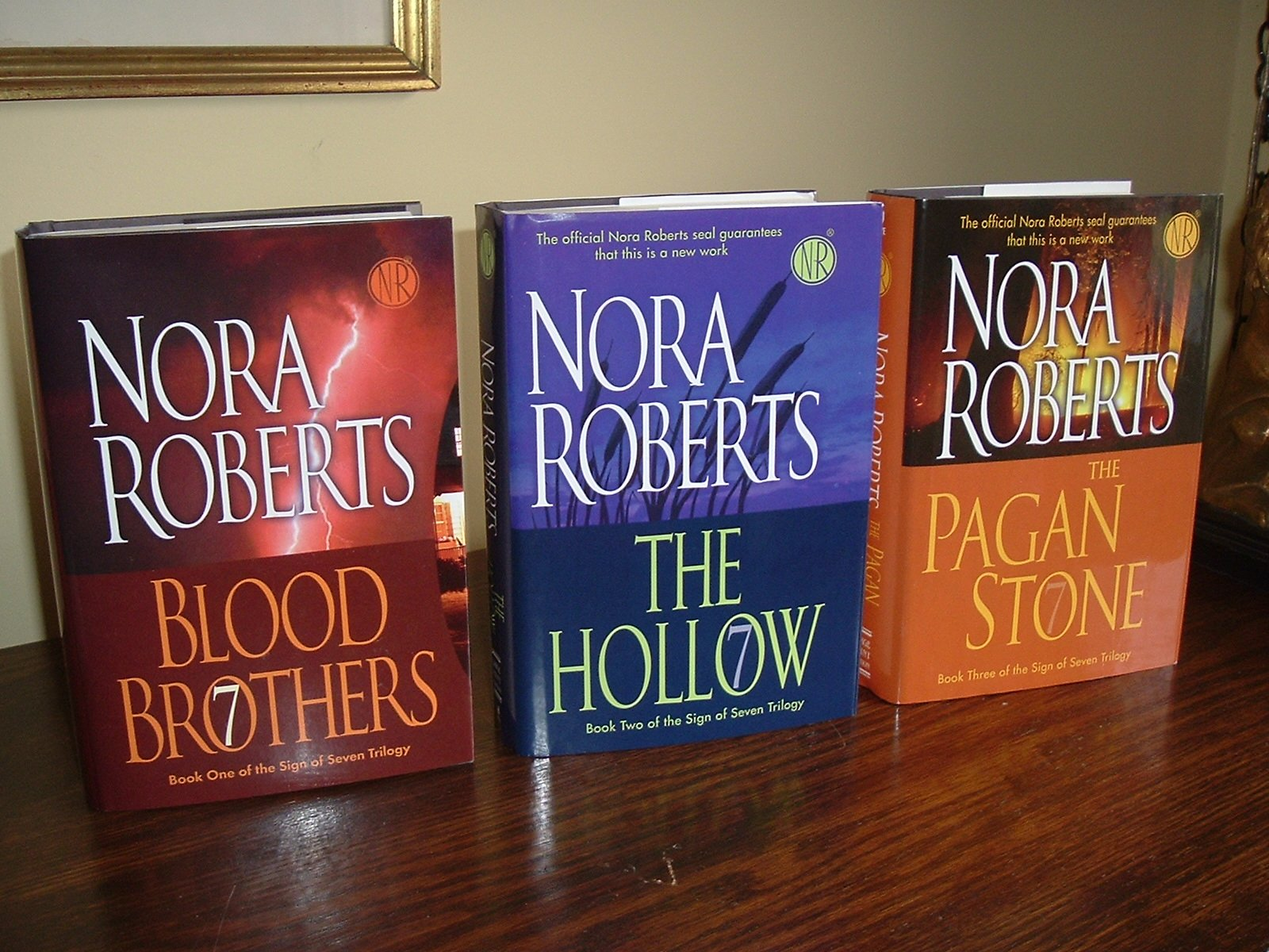 Sign of Seven Trilogy LARGE PRINT HC SET (Blood Brothers, The Hollow, The  Pagan Stone): Nora Roberts: Amazon.com: Books
