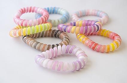 Pack de 10 gomas muelle multicolor. Envío GRATIS 72h: Amazon.es: Belleza