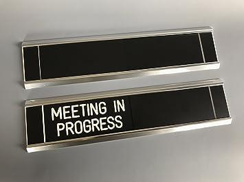 sliding door signs entry control meeting in progress