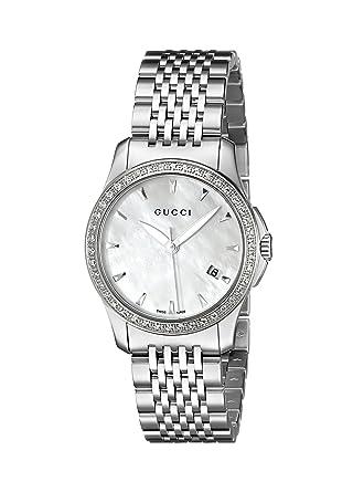eb974382329 Amazon.com  Gucci G-Timeless Diamond Bezel MOP White Dial Women s  Watch(Model YA126506)  Watches