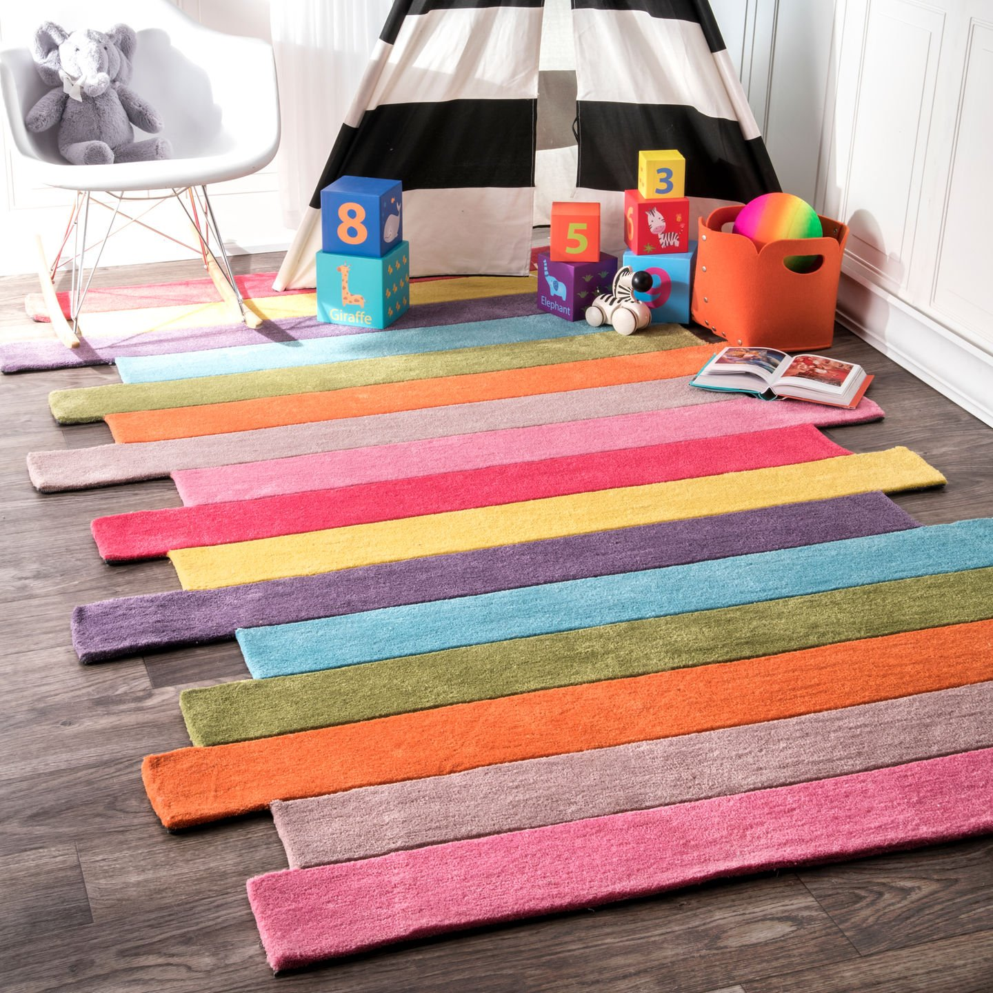 Colorful striped rug with asymmetrical edges.